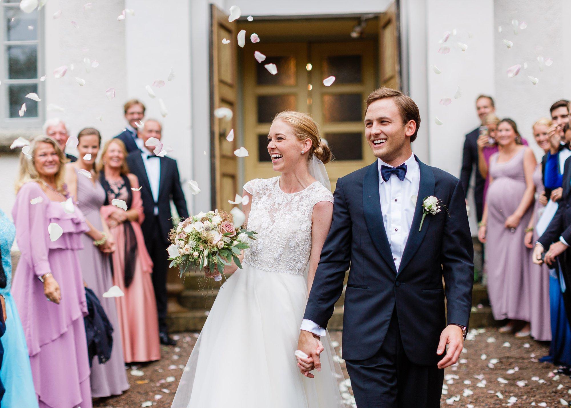 Newlyweds outside church wedding in Sweden